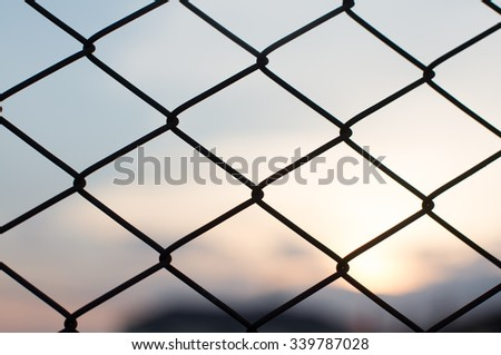 wire work in front of sunset  - stock photo