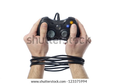 wired hands with joypad meaning videogame addiction - stock photo