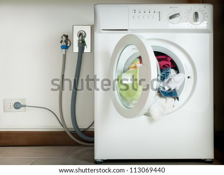 wired washing machine - stock photo