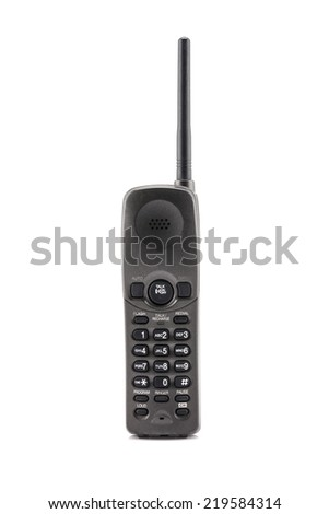 Wireless black telephone receiver on white background. - stock photo