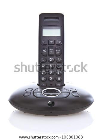 Wireless black telephone with cradle isolated on white background - stock photo
