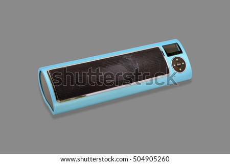 Wireless Bluetooth loudspeaker, mp3 player and radio for computer notebook and smart phone on gray background.