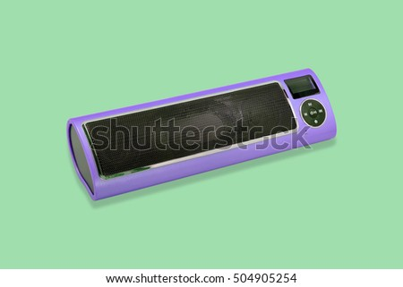 Wireless Bluetooth loudspeaker, mp3 player and radio for computer notebook and smart phone on green background.
