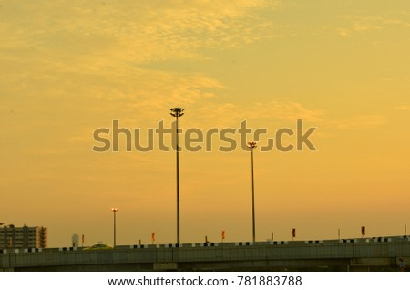 Wireless Communication Antenna With bright sky Telecommunication tower with antennas with golden sky.