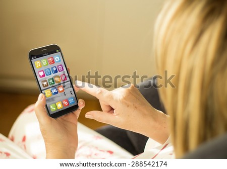 wireless communications concept: woman with a 3d generated smartphone. All screen graphics made up. - stock photo