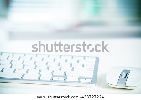 Wireless keyboard and wireless mouse on table in office. Selective focus. Toned photo  - stock photo