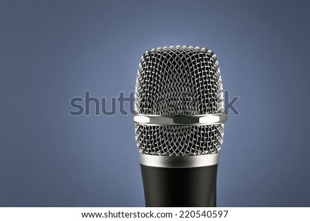 Wireless microphone closeup on blue background