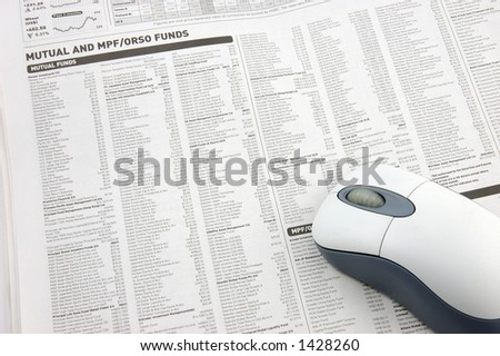 Wireless mouse over mutual funds data on newspaper - stock photo
