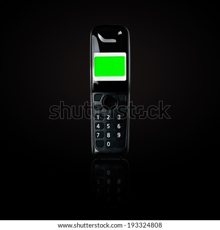 Wireless phone. Cordless phone with blank green screen and reflection on black gradient background. - stock photo