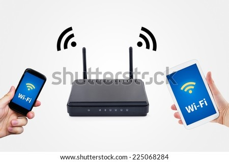 Wireless router with mobile device network concept  - stock photo