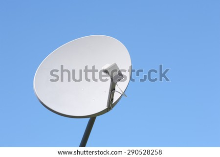 Wireless satellite dish with blue sky copy space. - stock photo