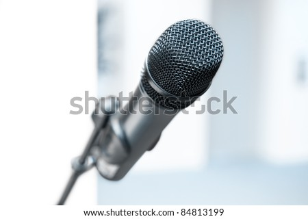 Wireless stereo microphone on a stand inside a high key room