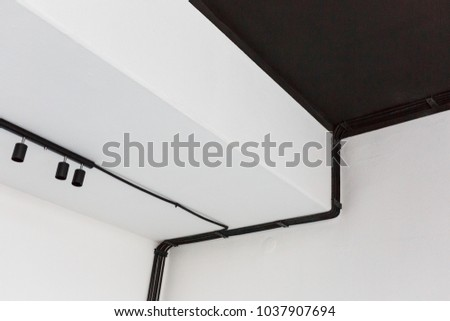 Wiring harness stock images royalty free images vectors wiring harness of black corrugated tubes on white wall goes to spot led lights keyboard keysfo Choice Image