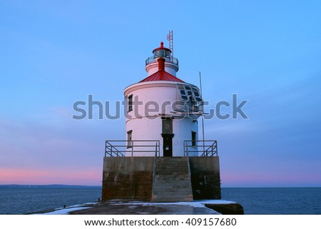 Wisconsin Point in Superior, WI Lighthouse on a Pink Winter Sunset - stock photo