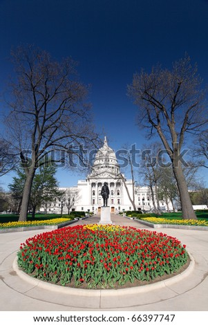 Wisconsin state capitol building in downtown Madison, Wisconsin is adorned with tulips. - stock photo