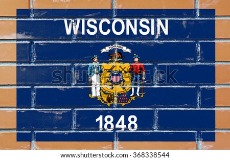 Wisconsin state flag of America on brick wall - stock photo