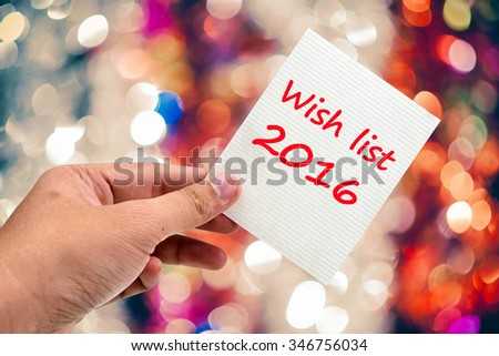 Wish list 2016 handwriting on a sticky note - stock photo