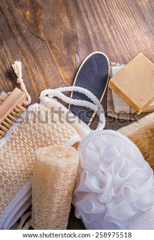wisps soap brush loofah on vintage wooden board  - stock photo