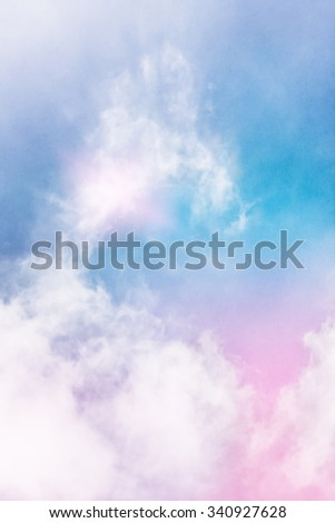 Wispy clouds and fog with a glowing light effect and a pink to blue color gradient.  Image displays a pleasing paper grain and texture at 100 percent. - stock photo