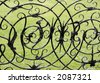 witch and witchcraft symbols on a wrought iron gate ashby hall northamptonshire the midlands england - stock photo