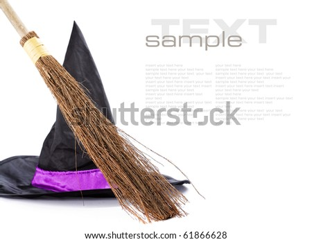 Witch broomstick and hat isolated on white background (with sample  text) - stock photo