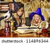 Witch  children with crystal ball. Halloween. - stock photo