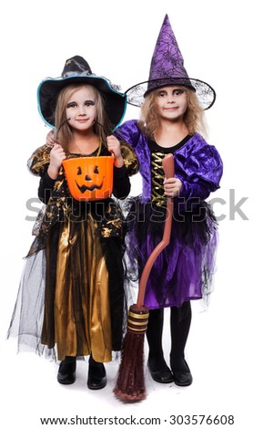 Witch children with trick or treat. Halloween. Fairy. Tale. Studio portrait isolated over white background - stock photo