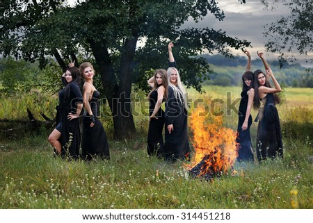 witch dancing by the fire - stock photo