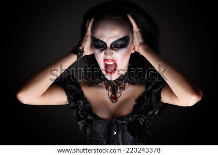 Witch.  girl in style Halloween. Terribly shouts - stock photo