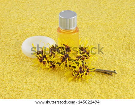 Witch Hazel Products on yellow towel