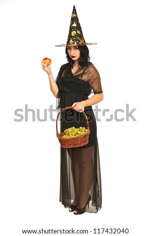 Witch holding autumn fruits isolated on white background - stock photo