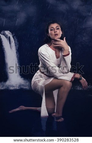 Witch in the river. Fantasy girl. Mysterious Night scene.  - stock photo