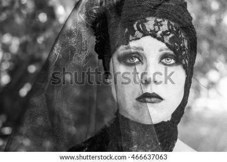 Witch on coven. Halloween. Gothic bride. Black and white photo.