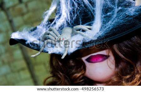 witch on Halloween with a spider
