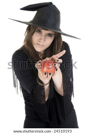 Witch treading us on a apple - stock photo