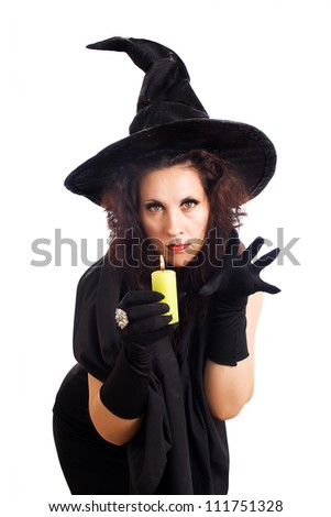 Witch with a candle casts a spell