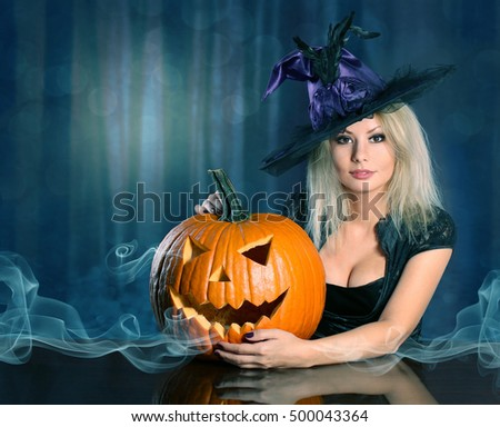 Witch with Halloween pumpkin. Beautiful blonde girl