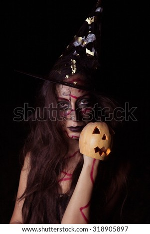 Witch with pumpkin