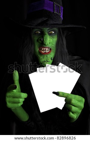 Witch with space for text, black background. - stock photo