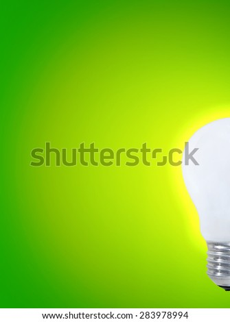Wite bulb isolated on green. - stock photo