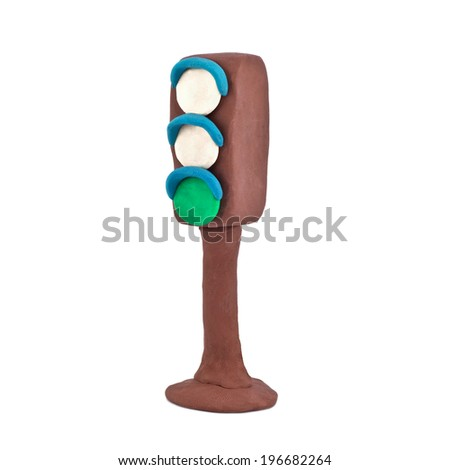 with a green traffic light signal is isolated on a white background - stock photo