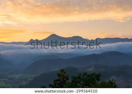 With a light mist on the mountain in the morning. - stock photo