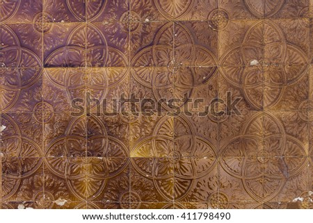 With colorful tiles decorated house wall in an old house in Portugal - stock photo