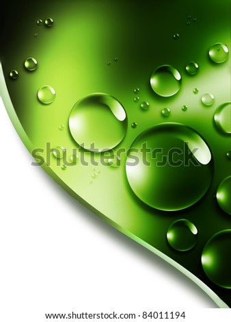 with drops of dew on a green leaf - stock photo