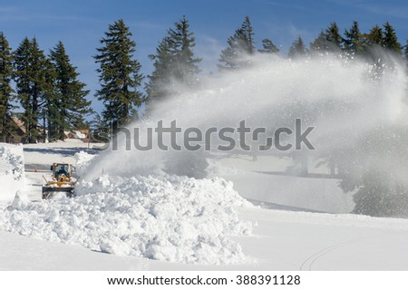 With 10-15 feet of snow a year, snow blowing is a full time activity to keep the roads clear for visitors at Crater Lake National Park. Oregon.