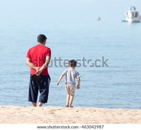 with his son on the beach father