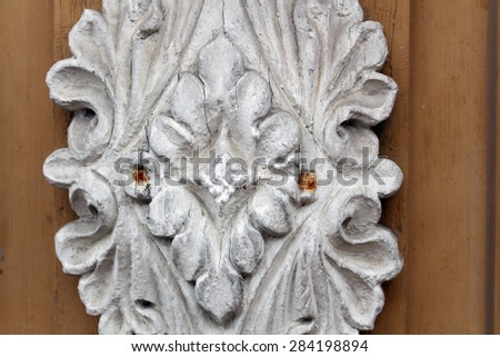 With ornament of entry. Antique ornament. Luxury wooden furniture with natural wood.