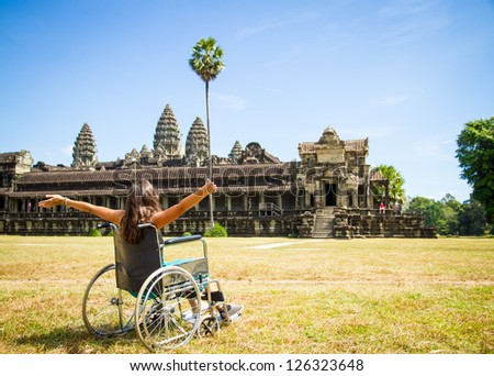 with wheelchair at Angkor Wat - stock photo