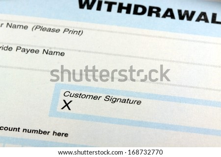 Withdrawal slip from bank checking or savings account - stock photo