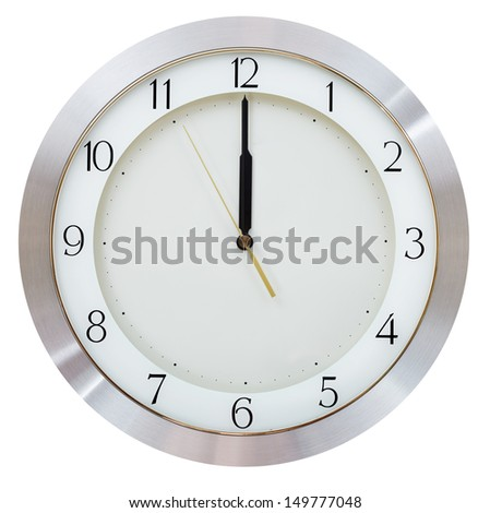 without five seconds twelve o clock on the dial round wall clock - stock photo